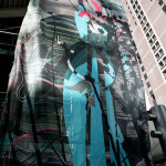 Installation at the Denver Performing Arts Complex of a 16 ft x 25 ft mesh panel
